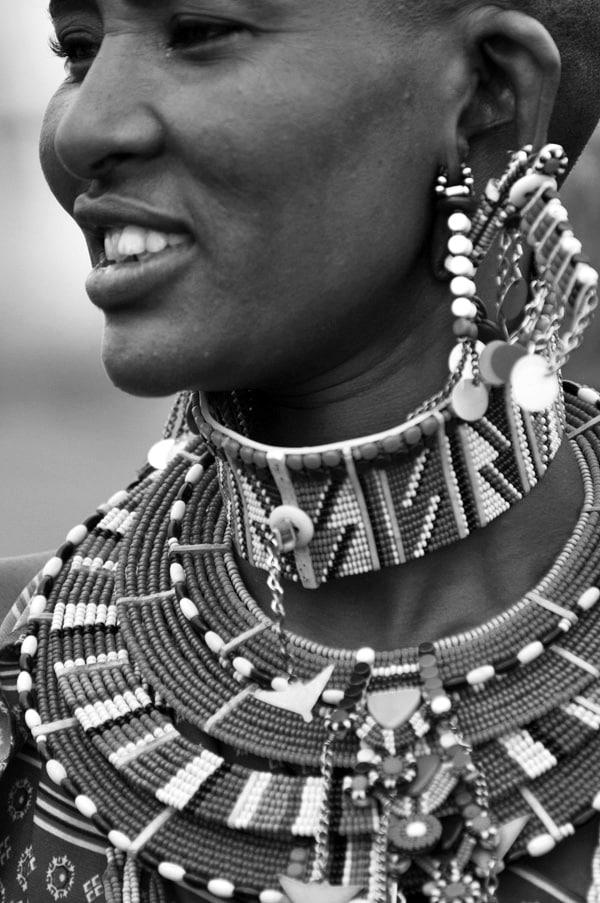 A Maasai woman wearing multi-colored beauty accessories
