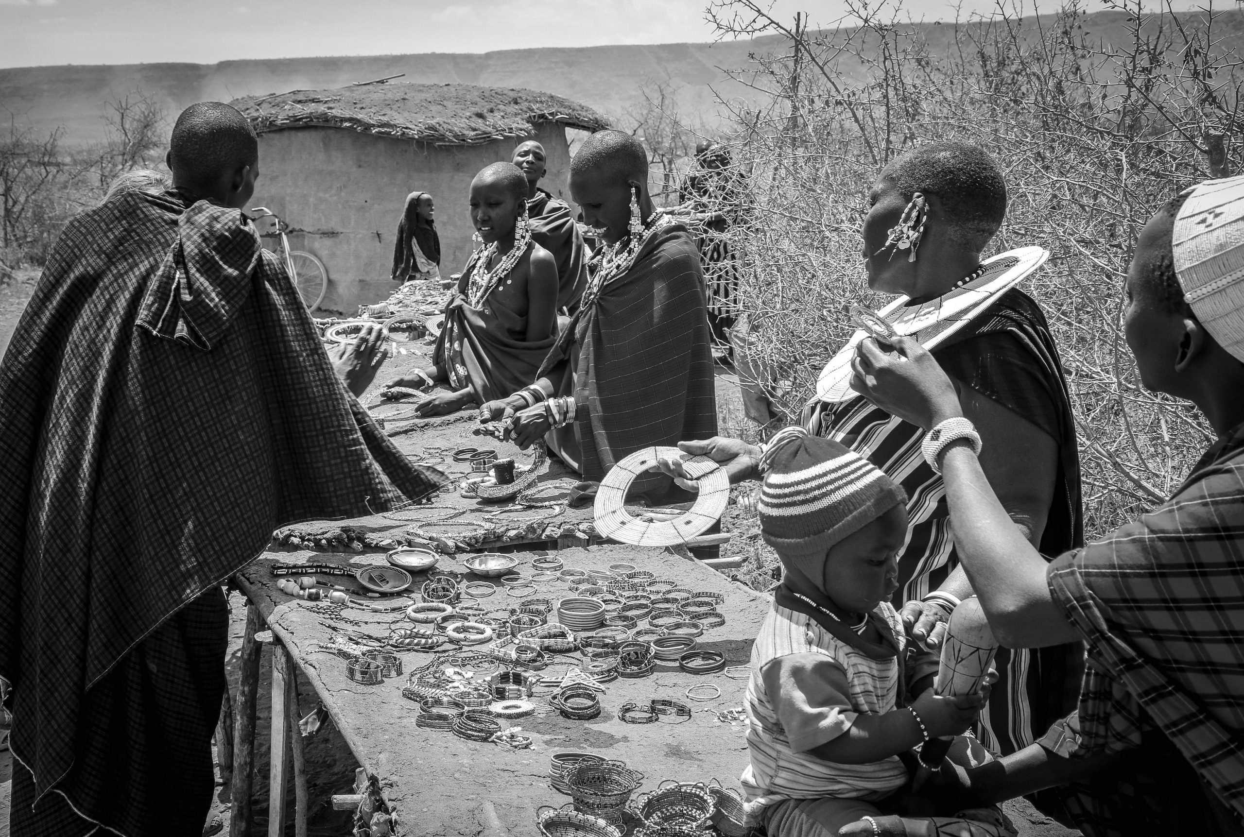 Maasai women selling necklaces and their beauty accessories