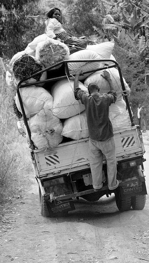 A small truck in Tanzania trying to navigate one of the unpaved bad roads in the country