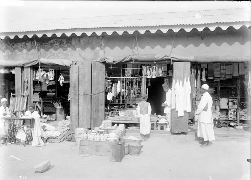 Shops owned by Indians with people roaming around in year 1906